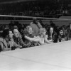 Vancouver Sun reporter Pete McMartin who for this event was writing for the strike newspaper The Express sits to the right of the three women at ring side waiting for the first bout to start.