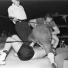 Referee Dave Brown and Tony Dowling pull Mike Mitchell from Jack Dombrowski who Mitchell has pushed through the ropes.