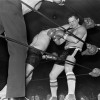 Louis Richards (right) during his final bout of the night. His opponent (centre) is  Louie Torrao